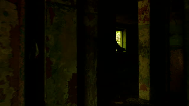 Walking into the abandoned building. Smooth and slow steady cam shot. video