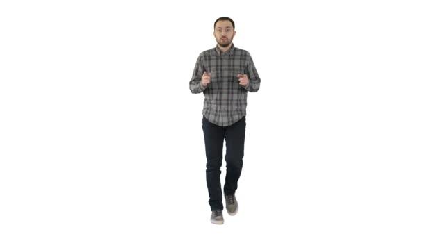 Walking man pointing and explaining something on white background