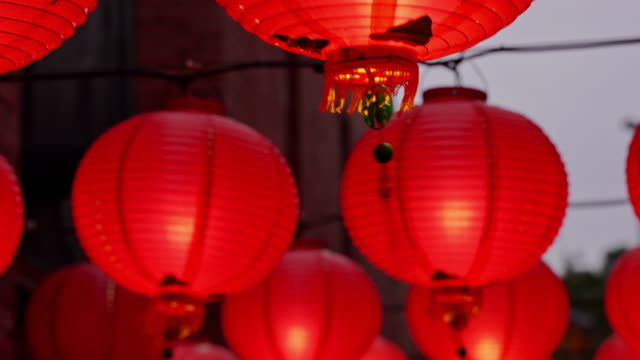 Walking on a Chinese traditional street at night with beautiful round red lantern hanging and swaying, concept of lunar new year festival. Walking on a Chinese traditional street at night with beautiful round red lantern hanging and swaying, concept of lunar new year festival, close up. The undering word means blessing. lantern stock videos & royalty-free footage
