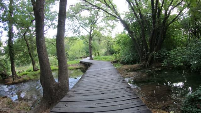 Walking on a footbridge at Krka National Park, Croatia