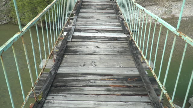 Walking on a old and dangerous suspended bridge