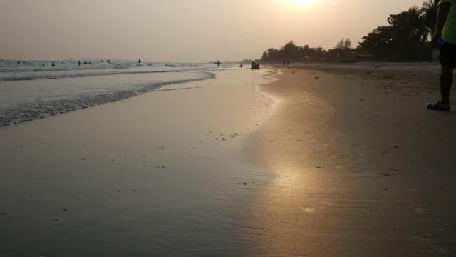 walking on beach at sunset video