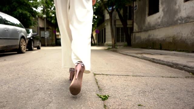 Walking on city street slow motion Walking on city street slow motion human foot stock videos & royalty-free footage