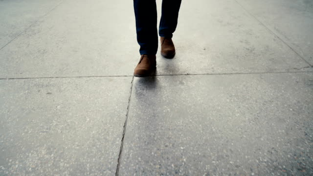 Walking on concrete : close-up view of man's leather shoes video
