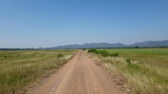 walking on dirt road in rural. - wiejska droga filmów i materiałów b-roll