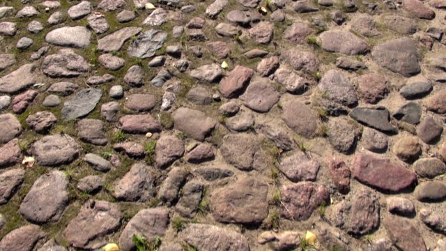 walking on old cobble-stone road. video