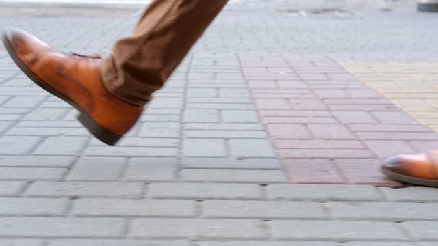 Walking on paving stones. Legs close up. Walking on the street. Walking on paving stones. Legs close up. Walking on the street human foot stock videos & royalty-free footage