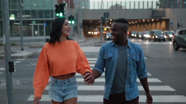 Walking on the streets of Milan Multi-ethnic couple having fun walking in Milan,Italy falling in love stock videos & royalty-free footage