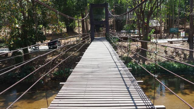 walking on wooden bridge