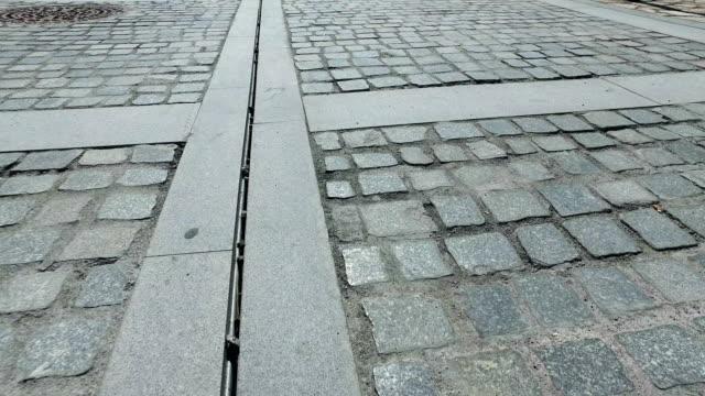 Walking pov over stone pavement, 4k steadicam video