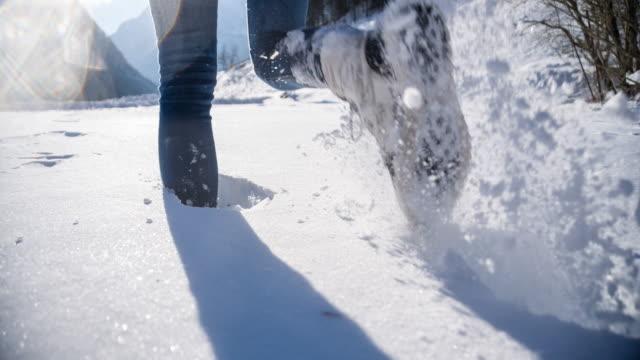 Walking through fresh snow in winter landscape video