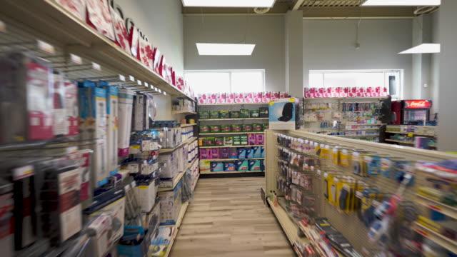 Walking Through Pharmacy Aisles A short POV walk-through of a medical pharmacy pharmacien stock videos & royalty-free footage