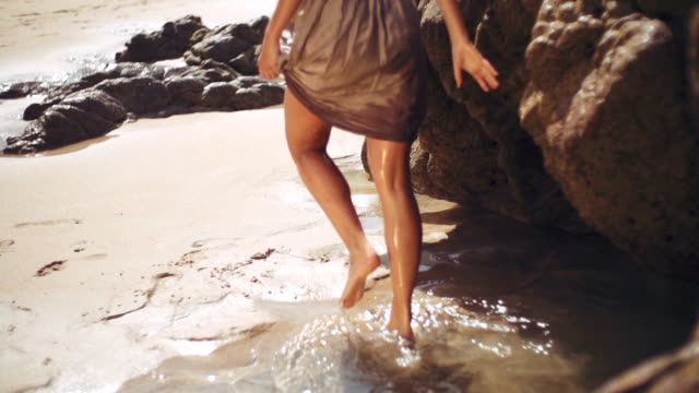 walking through rock pool - beach fashion stock videos and b-roll footage