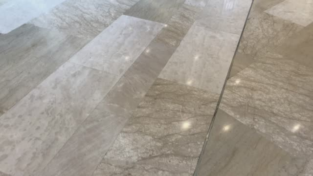 walking through the luxury marble in the building - piastrella video stock e b–roll