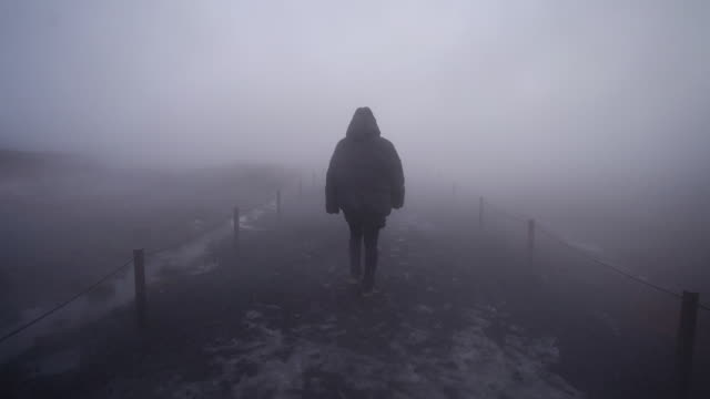 Walking through thick fog on Iceland