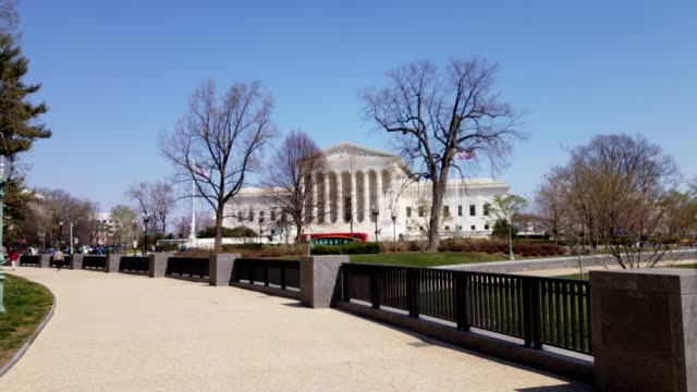 Walking toward the Supreme Court of the United States in Washington, DC Walkway from the Capitol to the United States Supreme Court in Washington DC architectural column stock videos & royalty-free footage