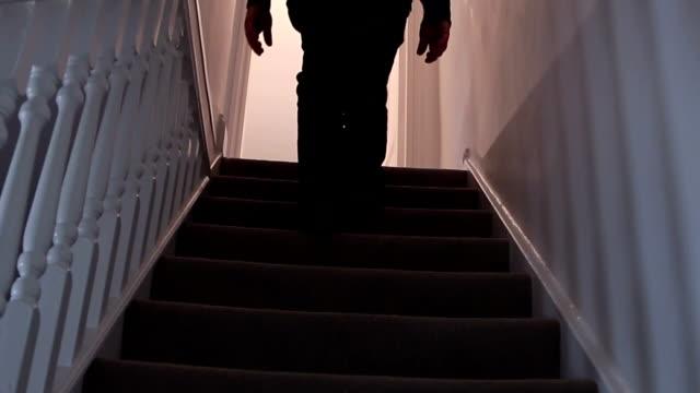 walking upstairs at night. - trappa bildbanksvideor och videomaterial från bakom kulisserna