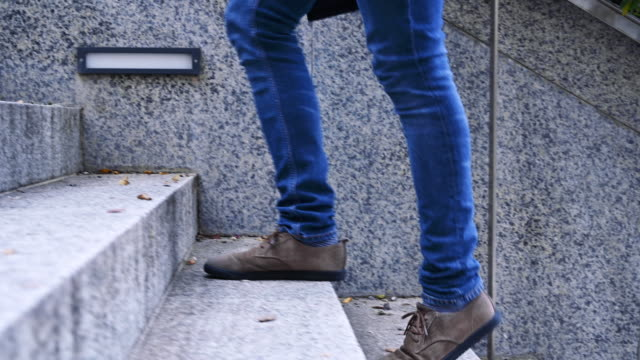 Walking upstairs, close-up view of man's leather shoes climbing up stairs. Walking upstairs, close-up view of man's leather shoes climbing up stairs. staircases stock videos & royalty-free footage