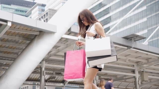Walking women with shopping bags video