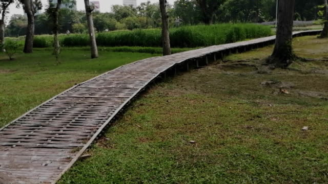 Walkway made of woven bamboo in the park