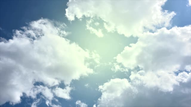 Wall breaking and falling down. Cloudy blue sky and sun appearing. video