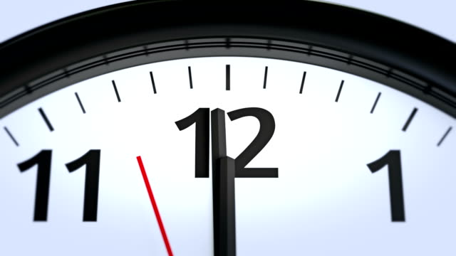 Wall Clock Close-Up Approaching Twelve O'Clock video
