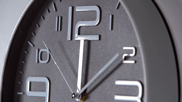 Wall clock on a gray background. 00:10 Round gray wall clock on a gray background. 00:10 wall clock stock videos & royalty-free footage