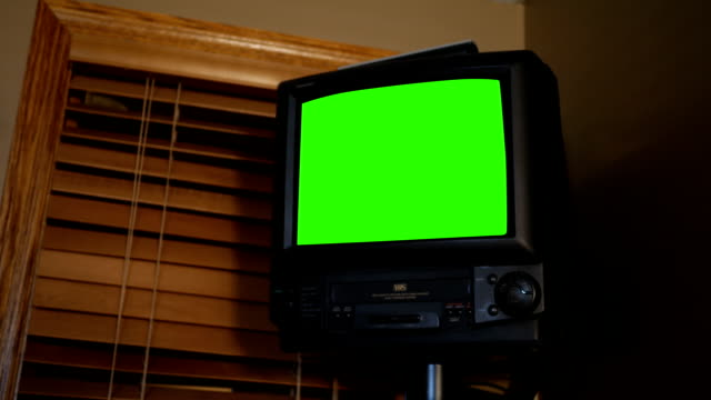 Wall Mount Green Screen VHS TV from the 1990s on wall in office