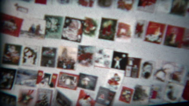 1960: Wall of Christmas cards collected from the year's batch of printed communications.