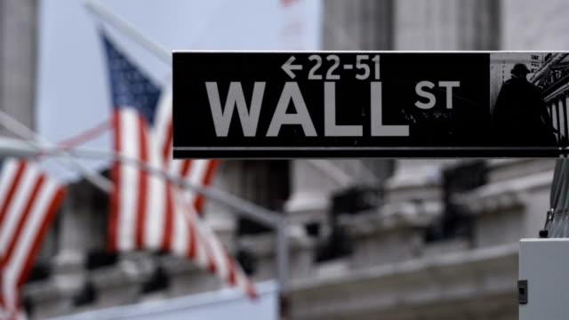 Wall Street financial district NYC establishing shot May 2016 An establishing shot of New York City's Iconic Wall Street in Downtown Manhattan. wall street stock videos & royalty-free footage