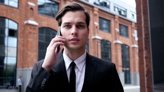 Wallking Businessman Talking on Phone, Negotiation video