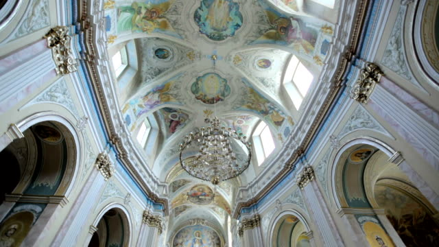 walls and ceiling of the church are painted with icons video