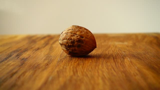 walnut cracking. the slow motion. - noci video stock e b–roll