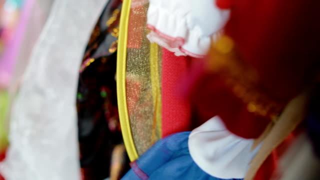 Wardrobe full of children's carnival costumes video