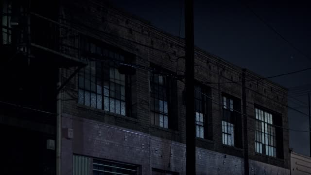 Warehouse Exterior Night Brick warehouse exterior at night in industrial area loft apartment stock videos & royalty-free footage