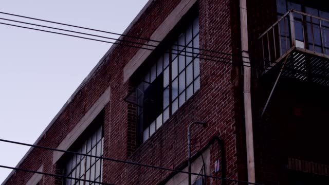 Warehouse Exterior windows Warehouse exterior windows in industrial area loft apartment stock videos & royalty-free footage