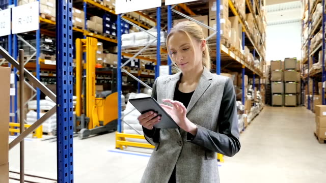 Warehouse female manager using tablet video
