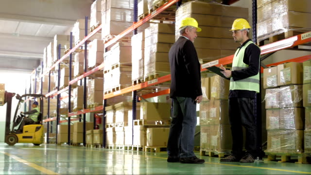 Warehouse Foreman Talking With An Employee video