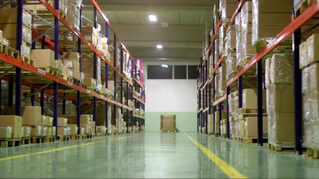 Warehouse Interior After Work HD1080p: DOLLY shot of the warehouse interior,  as the lights are turning off after work. start button stock videos & royalty-free footage
