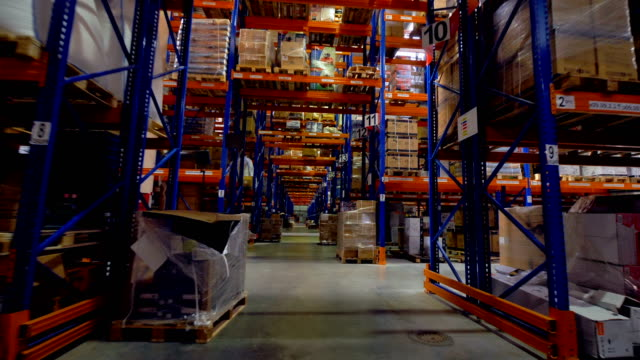 Warehouse interior. Storage facility with no people. Steadicam shot. 4K. video