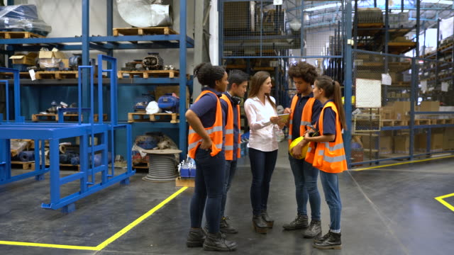 Warehouse manager meeting with workers in factory