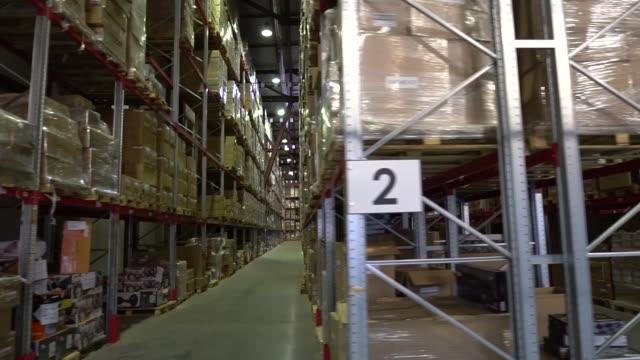 warehouse, storage at the enterprise. large racks 5 - tavolozza video stock e b–roll