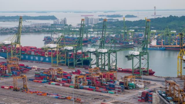 vídeos de stock, filmes e b-roll de armazém timelapse importação exportação - porto distrito