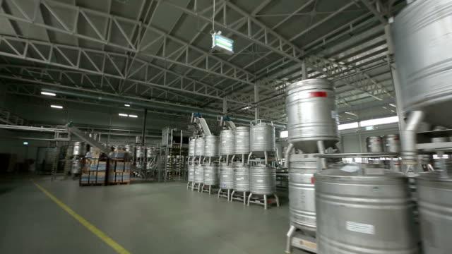 Warehouse With Metal Barrels
