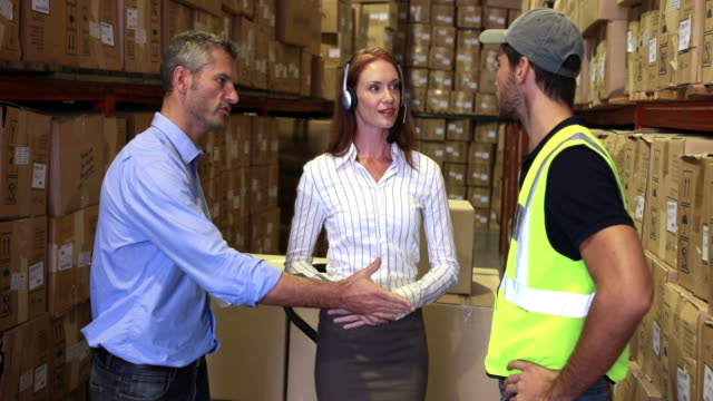 Warehouse worker talking with management video