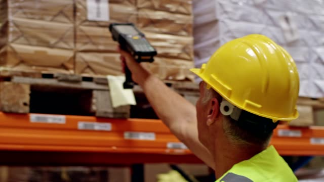 Warehouse worker using bar code reader Man checking stocks with bar code reader warehouse stock videos & royalty-free footage
