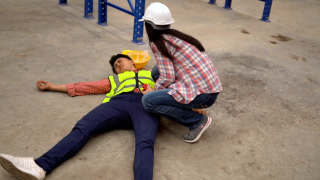 Warehouse workers after an accident