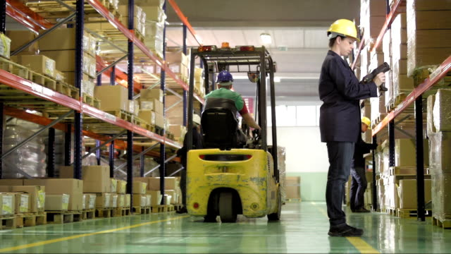 Warehouse Workers Doing An Inventory video