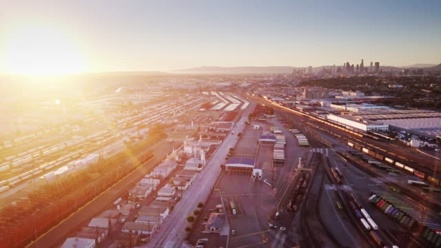Warehouses and Freight Yard Near Downtown LA at Sunset - Aerial Shot video