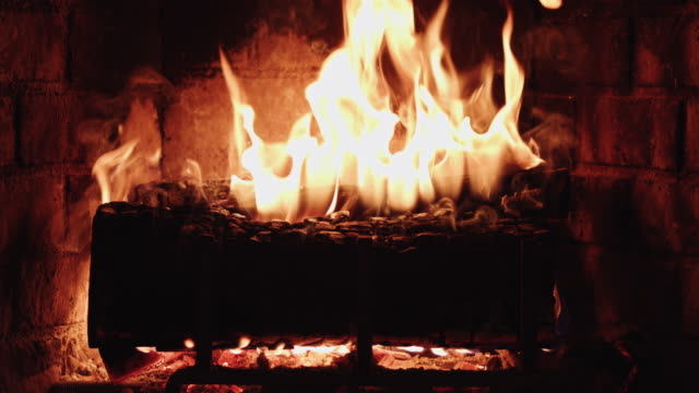 Warm Fire Burning in a Domestic Fireplace 4K video of flames burning in a log fireplace. fireplace stock videos & royalty-free footage